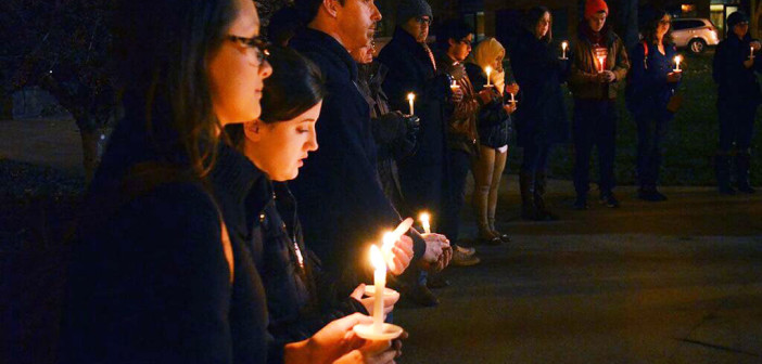 Candlelight vigil lights up campus